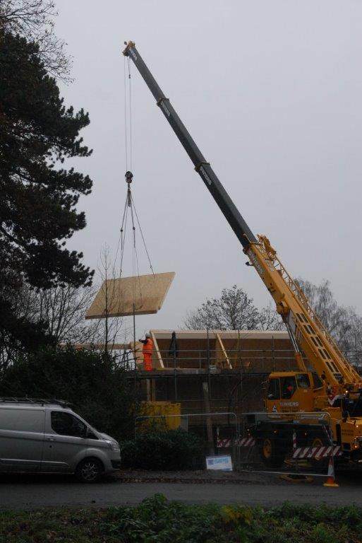Roof panel being lifted into place